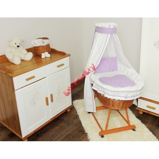 Wicker cot with purple set bedding