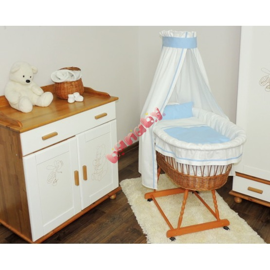 Wicker cot with blue set bedding