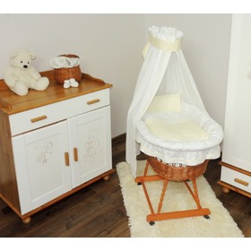 Wicker cot with white and cream set bedding